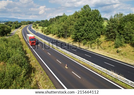 The rural landscape with a highway lined with trees, red truck and cars on the road, view from above #215664112