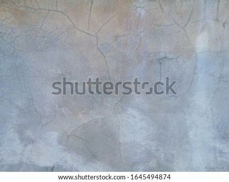 The​ rust​y effected​ to​ wall​ concrete​ for​ background.  Rust​y damaged​ to​ surface​ old​ wall​ for background. Rust wall​ background​ stock photo