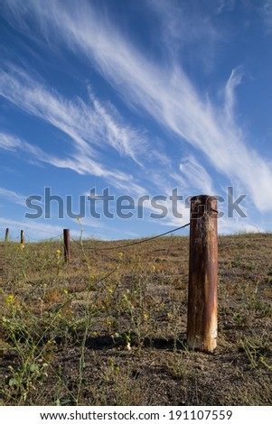 The rusted fence post in the Southern California desert.