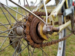 The rusty gear and chain.