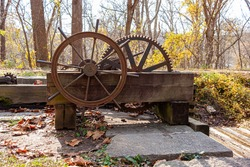 The rusty historic lock system consisting of a hand operated group of cogwheels used to pump water in and out of the locks in Chesapeake and Ohio Canal (C&O). This manmade water way is out of use now.
