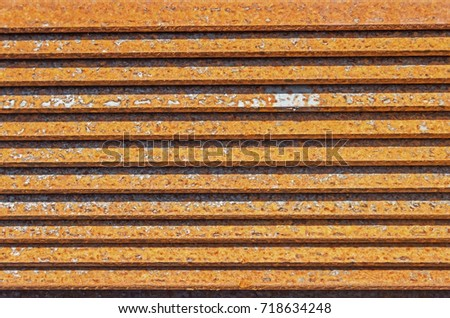 The rusty metal L-bar angle in packs at the warehouse of metal products piled in the open air Stock fotó ©