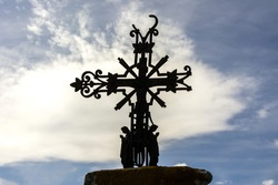 The rusty sculpture of the crucifixion on a cross in France