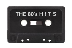 The 80s hits, old vintage 80's audio, hit songs compilation, retro mixtape, black tape audio cassette object isolated on white, cut out. Eighties music, old hits simple abstract concept, mix tape