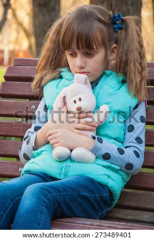 Free Photos Sad Little Girl Is Sitting On The Bench Avopixcom
