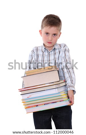 The sad schoolchild with a huge pile of heavy books in hands, on white background.