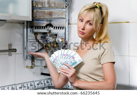 stock photo the sad woman the housewife counts up money for repair of a gas water heater 66235645 erotic toy, sex products supplies ,sex toy. Made with medical grade silicone