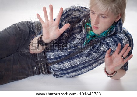 the sad young man leaned hands against wet glass