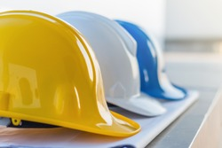 The safety helmet and the blueprint at construction site