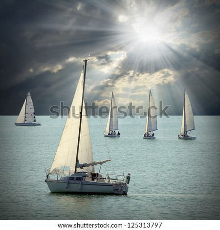 The Sailboats on a sea against a dramatic sky. Retro style picture.