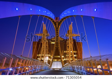 The Salford Quays lift bridge, also known as Salford Quays Millennium footbridge, is a 95-metre long vertical lift bridge bridge spanning the Manchester Ship Canal, in Greater Manchester.