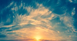 The salt rises above the pink and orange clouds - a gentle fairy-tale dawn - Dawn among bright fiery clouds at high altitude. Abstract photography.