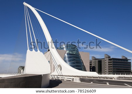 The Samuel Beckett Bridge is the newest bridge to cross the River Liffey in Dublin, Ireland. The modern structure is curved in the shape of a harp and uses cables, like a suspension bridge.