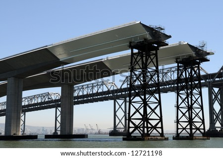 The San Francisco Bay Bridge, existing and new under construction spans - stock photo