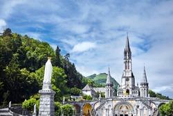 The Sanctuary of Our Lady of Lourdes or the Domain. Basilique de Notre-Dame de l'Immaculée-Conception de Lourdes. The Hautes-Pyrenees department in the Occitanie region in south-western France.