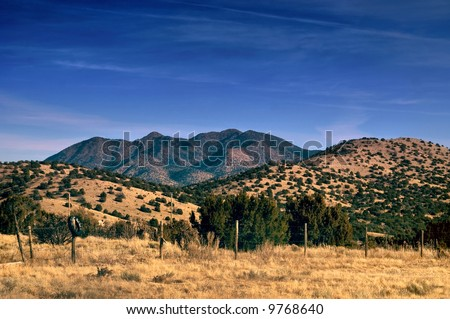 The Sandia Mountains captured in the desert of New Mexico just east of the city of Santa Fe in a rural and country setting