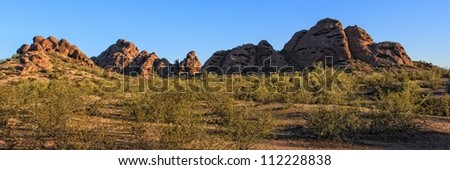 The sandstone buttes of Papago Park in Phoenix, Arizona surrounded by the landscape of the sonoran desert.