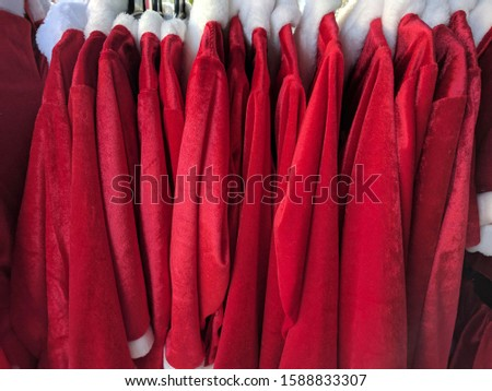 The Santa Claus clothes hanging on clothes hanger