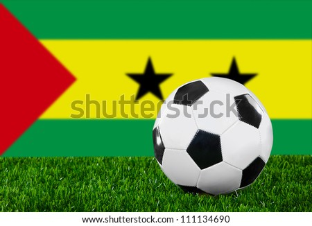 The Sao Tome and Principe flag and soccer ball on the green grass #111134690