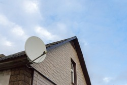 the satellite antenna installed on a house facade