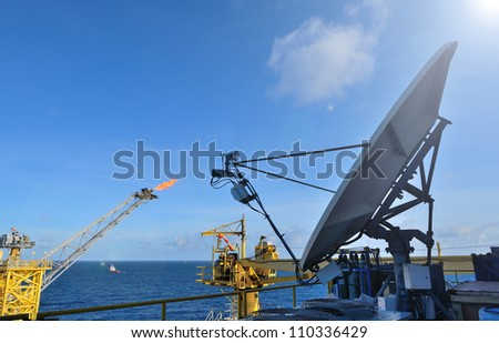 The satellite dish is set on the offshore oil rig platform in the gulf of thailand.