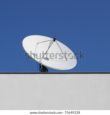 The satellite dish on the roof building.