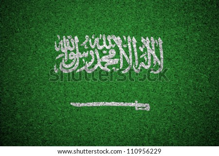 The Saudi Arabia flag painted on a cork board.