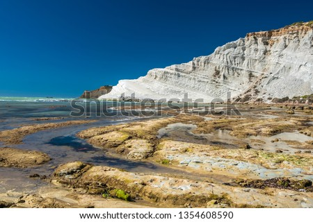 The Scala dei Turchi (Stair of the Turks), a spectacular white rocky cliff on the coast of Sicily, Italy. The rock formation in the shape of a staircase lies between two sandy beaches. #1354608590