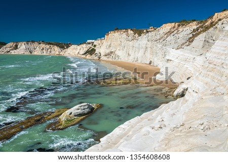 The Scala dei Turchi (Stair of the Turks), a spectacular white rocky cliff on the coast of Sicily, Italy. The rock formation in the shape of a staircase lies between two sandy beaches. #1354608608