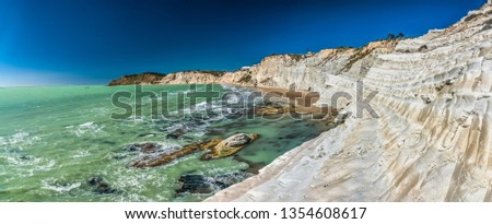 The Scala dei Turchi (Stair of the Turks), a spectacular white rocky cliff on the coast of Sicily, Italy. The rock formation in the shape of a staircase lies between two sandy beaches. #1354608617