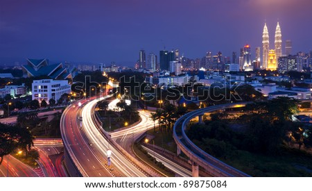 The scenario of Kuala Lumpur city, taken with slow shutter speed to get the light trail from the highway traffic. Stunning light trail at highway in Kuala Lumpur city