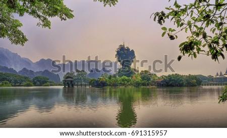 The scenery Kyauk Kalat Pagoda on the rocky island at Mawlamyine, Mon state, Myanmar. Stock fotó ©