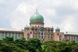 The scenery of Prime Minister's Office, Putrajaya, Malaysia with leaf green tree in the front