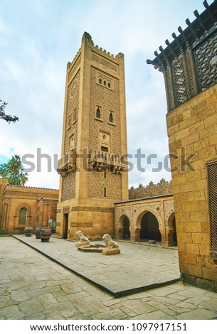 The scenic carved minaret of Manial Palace mosque also serves as the clock tower, Cairo, Egypt. #1097917151