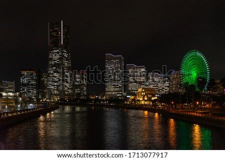 The scenic night skyline of Yokohama with the Landmark Tower and Cosmo Clock ferris wheel, Japan stock photo