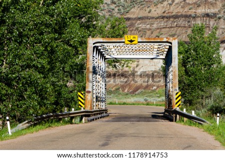 The scenic six kilometer road from Rosedale to Wayne near Drumheller, Alberta, Canada, you cross 11 one-lane metal bridges over the Rosebud River.  #1178914753