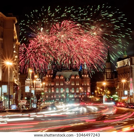 """The scenic summer fireworks during the  International Military Tattoo Music Festival """"Spasskaya Tower"""" in Moscow, Russia. View from Tverskaya street. #1046497243"""