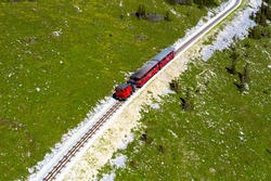 The SchafbergBahn is the steepest cogwheel railway in Austria. Since 1893 mighty steam locomotives have powered their way from the lake-side base station in St. Wolfgang to the 1783 m high