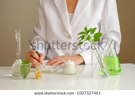 the scientist,dermatologist formulate organic natural cosmetic product in the laboratory.research and development beauty skincare .cream,serum.hand Stock photo ©