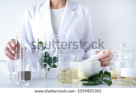 the scientist,doctor, make alternative herb medicine with herbal the organic natural in the laboratory. oil capsule, natural organic skincare and cosmetic.