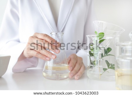 the scientist,doctor, make alternative herb medicine with herbal the organic natural in the laboratory. oil capsule, natural organic skincare and cosmetic. #1043623003