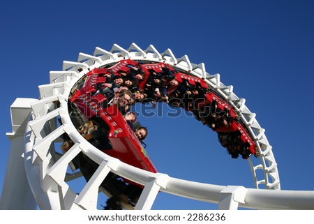The screams and thrills of a speeding rollercoaster. - stock photo