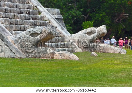 The sculpture at the base of the feathered serpent pyramid - Chichen Itza, Mexico