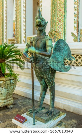 The sculpture of a mythical bird, namely Tan Ti Ma, belived be living in the Himalaya forest, inside the Temple of Emerald Buddha  Stok fotoğraf ©