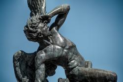 The sculpture of the fallen angel in madrid's retiro park