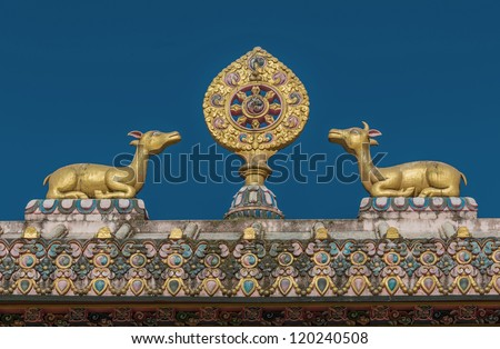 The sculpture of the wheel of Dharma and two deer on the roof of the gate of the monastery Tengboche - Nepal