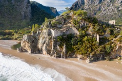 The sea and beach of Olympos (Olimpos) historic ancient city Hellenistic Roman Byzantine period. Kemer, Antalya, Turkey. Air view