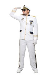 The sea captain in a white suit and sunglasses raised his hand at the level of his cap and looks into the distance, isolated on a white background.