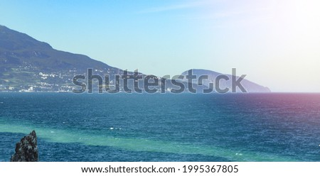 The sea coast of the Crimea, in the background is the famous mountain Ayu dag Bear Mountain. Stockfoto ©