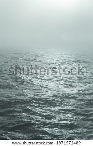 The sea in the fog. The line of the horizon, dissolving in the fog. Irish sea in fog. Foggy weather